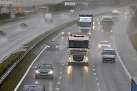 Cars and lorries on the M4 motorway, travel through rain and spray caused by Storm Gareth, near Margam in south Wales, UK. Tuesday 12 March 2019