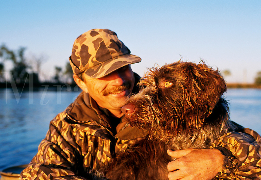 A hunter and his Wire Hair dog.