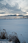 Early morning sunrise over Kootenai National Wildlife Refuge with clouds over the Cabinet mountains in the winter