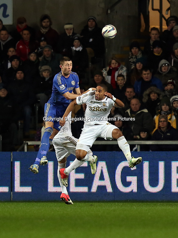 Wednesday 23 January 2013<br /> Pictured: Ashley Williams of Swansea (R) heads the ball away from Gary Cahill of Cheslea (L)<br /> Re: Capital One Cup semi-final second leg, Swansea City FC v Chelsea at the Liberty Stadium, south Wales.