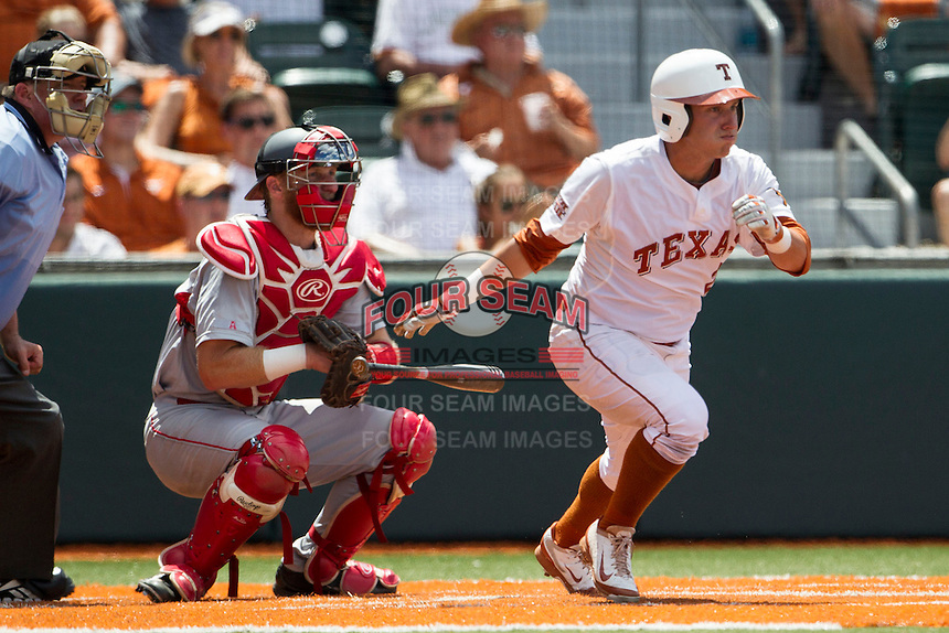 Texas Longhorns outfielder Mark Payton (2) follows through on his swing during the NCAA Super Regional baseball game against the Houston Cougars on June 7, 2014 at UFCU Disch–Falk Field in Austin, Texas. The Longhorns are headed to the College World Series after they defeated the Cougars 4-0 in Game 2 of the NCAA Super Regional. (Andrew Woolley/Four Seam Images)
