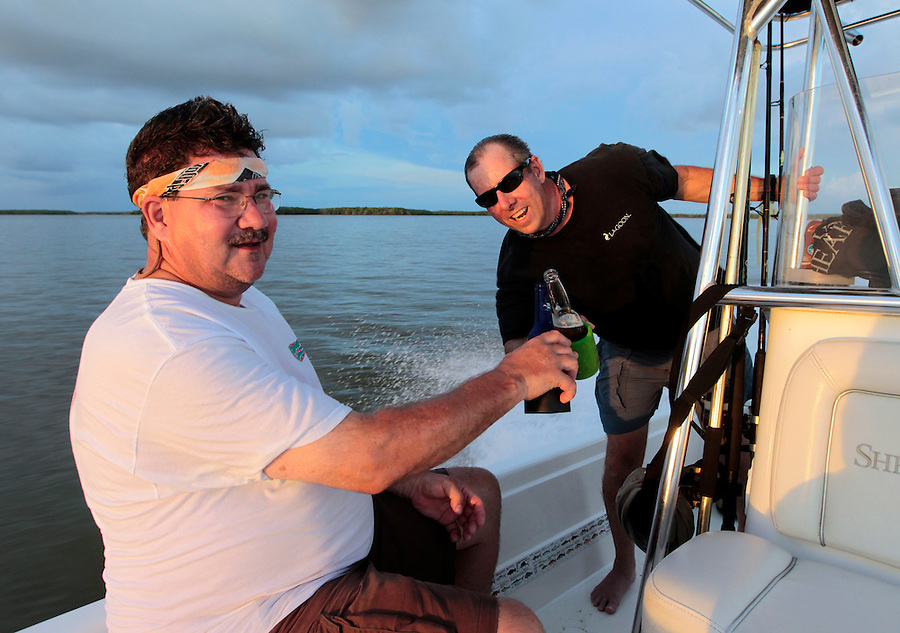 Steve Scalish toasts with Capt. Tom Shurtleff at speed in Florida's Everglades National Park out of Chokoloskee Island and the 10,000 Islands National Wildlife Refuge. Photo/Andrew Shurtleff