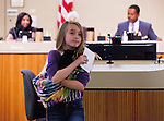 Michelle Coren, 11, of Brentwood, brought her rescued kitten Martin, to the city council meeting in Antioch, California on Tuesday, Apri 8, 2014.  Coren spoke to the council members about her rescue efforts and to plead with the council to not impose a feral cat feeding ban in public spaces in Antioch, California.  The Antioch City Council voted 4-1 to impose the feeding ban.Photo/Victoria Sheridan
