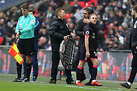 Alex Pritchard of Huddersfield Town is consoled by Huddersfield Town manager David Wagner after being substituted against his former club during Tottenham Hotspur vs Huddersfield Town, Premier League Football at Wembley Stadium on 3rd March 2018