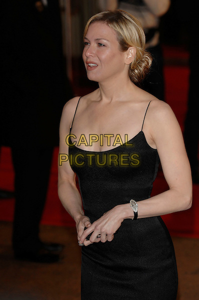 "RENEE ZELLWEGER..""Miss Potter"" World Film Premiere..Empire cinema, Leicester Square..London, England  3rd December 2006 ..half length black dress..CAP/PL..©Phil Loftus/Capital Pictures"