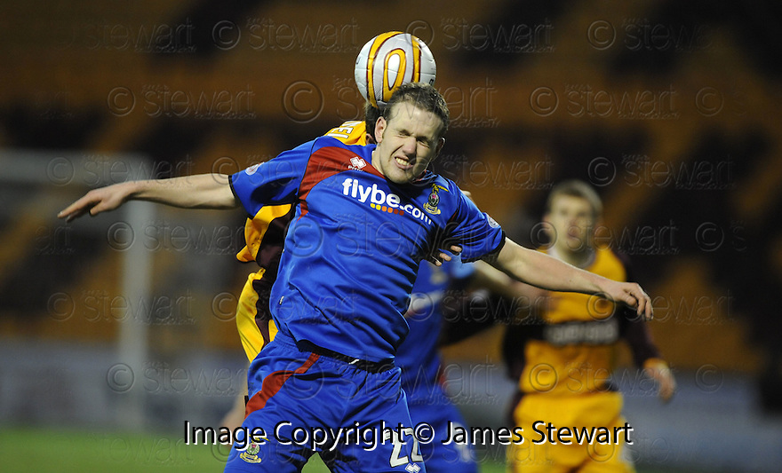 27/12/2008  Copyright Pic: James Stewart.File Name : sct_jspa27_motherwell_v_ICT.GARRY WOOD GETS KNOCKED FROM BEHIND BY STEVEN HAMMELL.James Stewart Photo Agency 19 Carronlea Drive, Falkirk. FK2 8DN      Vat Reg No. 607 6932 25.Studio      : +44 (0)1324 611191 .Mobile      : +44 (0)7721 416997.E-mail  :  jim@jspa.co.uk.If you require further information then contact Jim Stewart on any of the numbers above.........