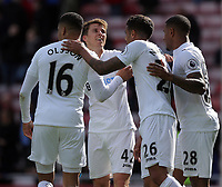 SUNDERLAND, ENGLAND - MAY 13: (L-R) Matrin Olsson, Tom Carroll, Kyle Naughton and Luciano Narsingh Swansea City celebrate their win during the Premier League match between Sunderland and Swansea City at the Stadium of Light, Sunderland, England, UK. Saturday 13 May 2017