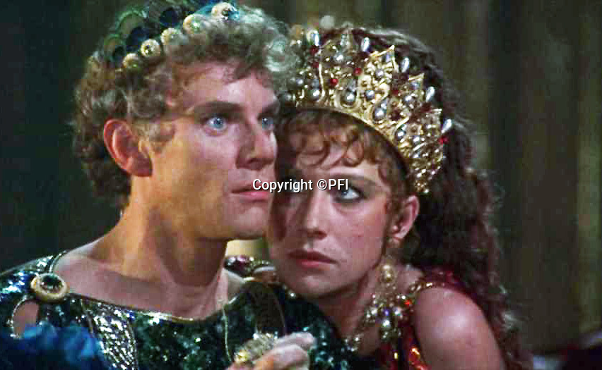BNPS.co.uk (01202 558833)<br /> Pic: PFI<br /> <br /> Malcolm McDowell and Helen Mirren starred in the controversial 1979 movie Caligula. <br /> <br /> Rock of Ages - Emperor Caligula's ring leads stellar exhibition at Royal Jewellers Wartski.<br /> <br /> A precious jewel, created for the most infamous of Rome's Emperor's nearly 2000 years ago, is causing gem collectors from around the world to flock to London as it goes on sale tomorrow.<br /> <br /> The exquisite solid sapphire hololith ring, a former star of the legendary collection of the 4th Duke of Marlborough in the 18th century, is thought to be valued at close to £500,000.<br /> <br /> The sky blue stone is etched with a portrait of his last wife, the notorious Caesonia, said to have been so beautiful that the depraved Emperor paraded her naked in front of his troops. <br /> <br /> She was played by Dame Helen Mirren in the controversial 1979 movie Caligula.<br /> <br /> The ring is the star attraction at a selling exhibition of over 100 engraved gems collected by Royal jewellers Wartski opening on Monday.<br /> <br /> The exhibition has sparked worldwide interest, with collectors from as far afield as Japan queueing outside their premises days before to be first through the door.