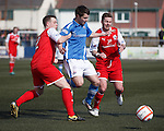 Ricky McIntosh squeezes through the Stirling defence