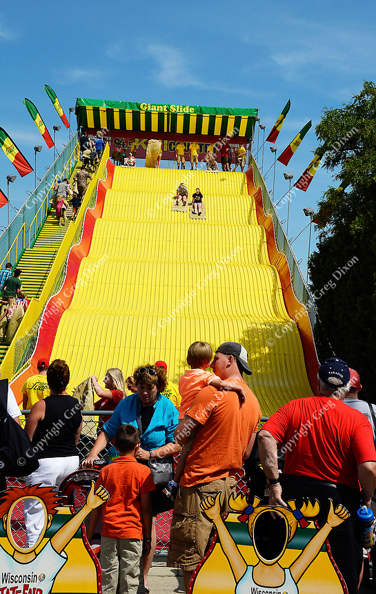 Kids and families enjoy the Giant Slide at the 2015 Wisconsin State Fair on Thursday, August 6, 2015 in West Allis, Wisconsin