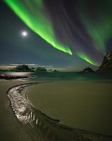 Northern Lights - Aurora Borealis fill sky over Haukland beach, Vestvågøy, Lofoten Islands, Norway