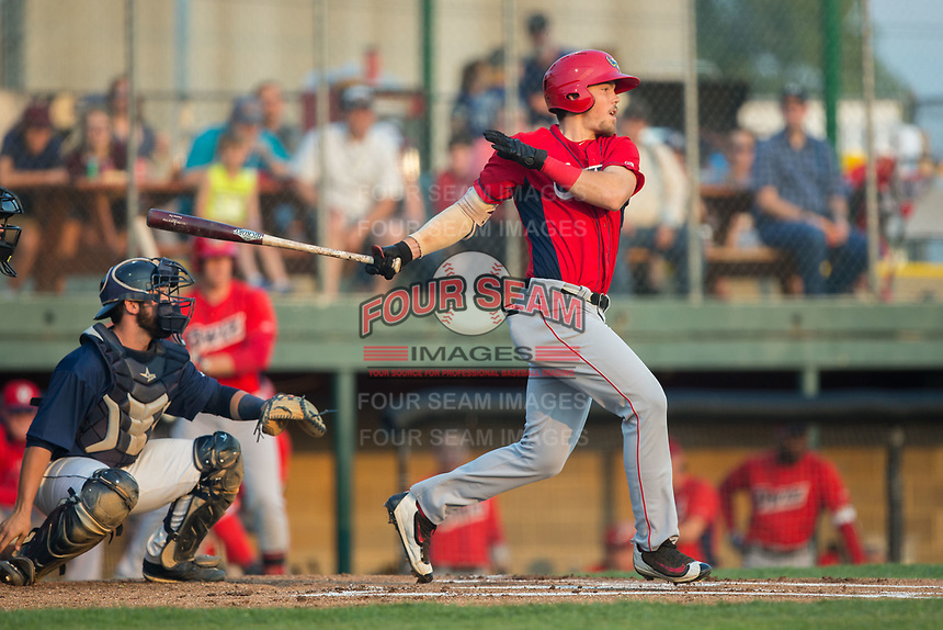 Brandon Marsh (18) of the Orem Owlz follows through on his swing against the Helena Brewers at Kindrick Legion Field on August 17, 2017 in Helena, Montana.  The Owlz defeated the Brewers 5-2.  (Brian Westerholt/Four Seam Images)