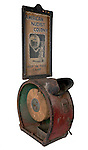 1998.13 <br /> Crank Peep Show Machine. <br /> Ca. 1930s.<br /> Metal, paper, glass, photographs.<br /> Peep show called American Nudist Colony/Gales Photo Modesty/Peep in there [sic] Camp.<br /> Made by International/Autoscope Reel Company, New York.<br /> The peep show came from Polock Johnny's, 424 East Baltimore Street, a business started by the donor's grandfather, John Charles Kafka (1900-1992).<br /> Gift of Margaret Kafka.<br /> Museum Department.
