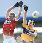 Ruairi Deane of Cork in action against Ciaran Russell of Clare during their National Football League game at Cusack Park. Photograph by John Kelly.