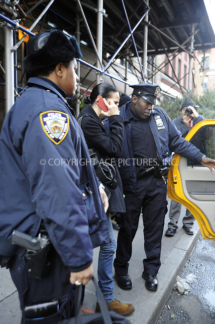 WWW.ACEPIXS.COM....December 5 2012, New York City....Actress Jennifer Connelly tries to hide amongst some Christmas trees whilst she waits for a cab in Soho, and eventually enlists some NYPD officers for an escort to a cab on December 5 2012 in New York City....By Line: Curtis Means/ACE Pictures......ACE Pictures, Inc...tel: 646 769 0430..Email: info@acepixs.com..www.acepixs.com