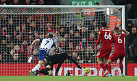 30th November 2019; Anfield, Liverpool, Merseyside, England; English Premier League Football, Liverpool versus Brighton and Hove Albion; Liverpool goalkeeper Adrian scrambles to make a save as Neal Maupay of Brighton and Hove Albion chases  - Strictly Editorial Use Only. No use with unauthorized audio, video, data, fixture lists, club/league logos or 'live' services. Online in-match use limited to 120 images, no video emulation. No use in betting, games or single club/league/player publications