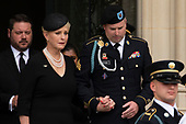 Cindy McCain and Jimmy McCain follow a Military Honor Guard carrying the casket of late Senator John McCain, Republican of Arizona, after a funeral service at the National Cathedral in Washington, DC on September 1, 2018. Credit: Alex Edelman / CNP