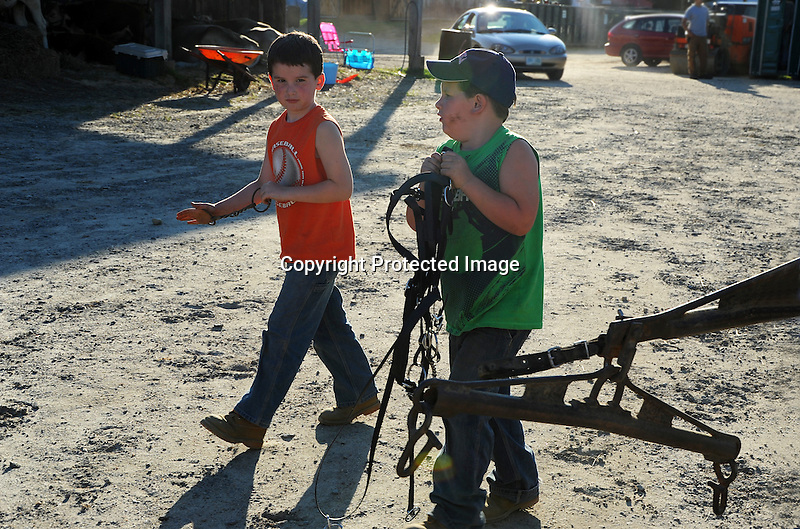 Two young boys helping with the tack at Cheshire Fair in Swanzey, New Hampshire USA