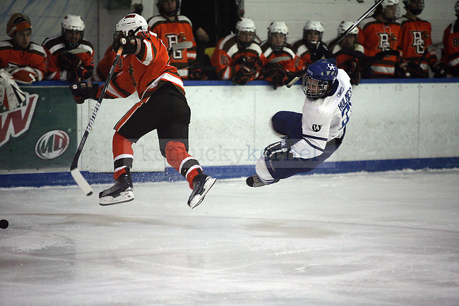 Alex Holmes gets knocked down after a body check by Bowling Green State University player at the Lexington Ice Center on November 7, 2010. Photo by Ryan Buckler | Staff