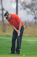 Marcel Siem (GER) putts onto the 17th green during Friday's Round 2 of the 2014 BMW Masters held at Lake Malaren, Shanghai, China 31st October 2014.<br /> Picture: Eoin Clarke www.golffile.ie