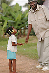 A doting man greets a happy girl in  Barranco, Belize. Baranco is a Garrifuna village bordering Sarstoon-Temash National Park.