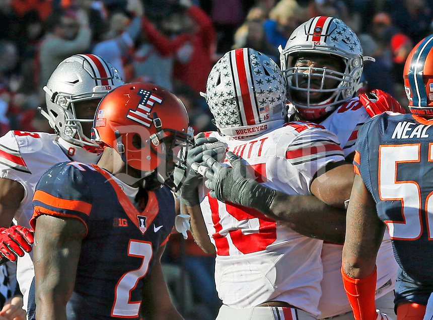Ohio State Buckeyes running back Ezekiel Elliott (15) is congratulated by  Ohio State Buckeyes offensive lineman Chase Farris (57) after his one yard touchdown dive in the second half of their game at Memorial Stadium in Champaign, Ill on November 14, 2015. (Columbus Dispatch photo by Brooke LaValley)