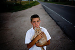 TIME, Arapahoe County Assignment..Small towns in far eastern Arapahoe County.  Byers, Deer Trail, Aurora, Watkins....Tanner means with his grandmother's cat in rural Byers, Colorado.  Although property values in the Denver metropolitan area have skyrocketed in recent decades, the economic situation in eastern Colorado remains subdued.  Arapahoe County is one of the most populous counties in the United States, though encompasses a large swath of rural, eastern Colorado.