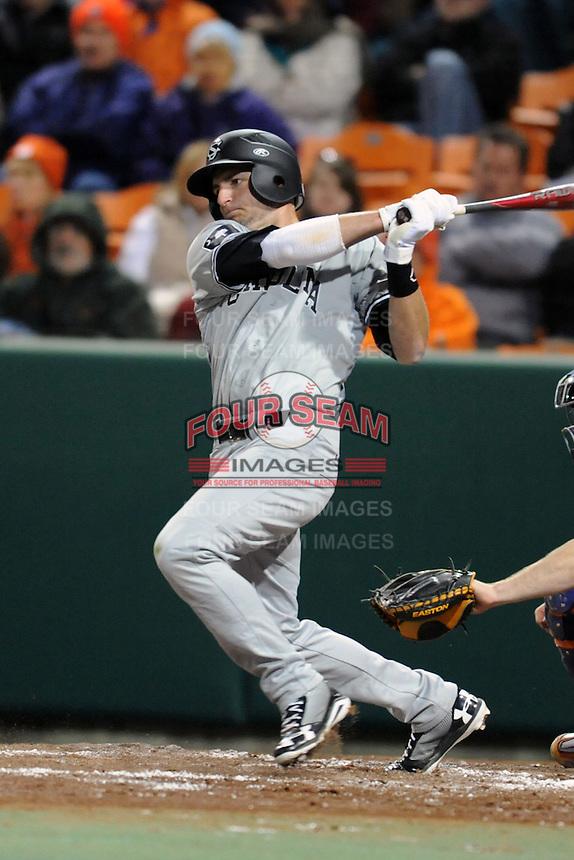 South Carolina Gamecocks left fielder Graham Saiko #26 swings at a pitch during a game against the Clemson Tigers at Doug Kingsmore Stadium on March 1, 2013 in Clemson, South Carolina. The Gamecocks won 6-0.(Tony Farlow/Four Seam Images).