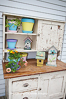 63821-202.11 Potting bench with containers, birdhouses and flowers in spring, Marion Co. IL
