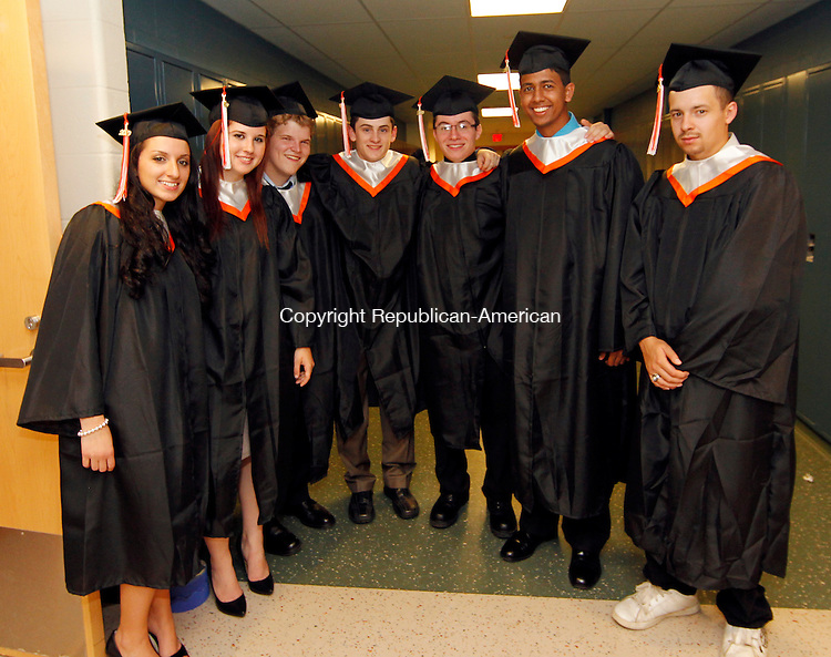 Watertown, CT-18, June 2010-061810CM02  Watertown graduates pose for a photo before heading into commencement exercises Friday night at Watertown High School.   --Christopher Massa Republican-American