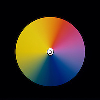 NEWTON'S COLOR DISK (2 of 2)<br /> Moderate Spin, Colors Blurred &amp; Mostly Visible<br /> The eye retains images for very short periods of time. As the disk spins the color impulses reaching the eye will overlap resulting in a combination of colors. The faster the impulses (spin) the less distinct the colors become until the disk looks gray.