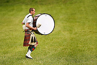 A drummer makes his way across the field during the Loch Norman games in Huntersville, NC.