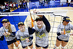 PENSACOLA, FL - DECEMBER 09: Shelby Seurer (4) of Concordia University, St. Paul, center right, cuts a portion of the net during the Division II Women's Volleyball Championship held at UWF Field House on December 9, 2017 in Pensacola, Florida. (Photo by Timothy Nwachukwu/NCAA Photos via Getty Images)