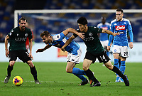 1st December 2019; Stadio San Paolo, Naples, Campania, Italy; Serie A Football, Napoli versus Bologna; Fernando Llorente is challenged by Takehiro Tomiyasu of Bologna - Editorial Use