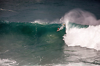 Surfers riding a wave at the 2016 Big Wave Eddie Aikau Contest, Waimea Bay, North Shore, Oahu