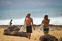 North Shore/Oahu/Hawaii (Friday, November 25, 2011) Adrain Buchan (AUS) and Damien Wills (AUS). – Free surfing session at Rocky Point in 3'-4' side shore trades. . Photo: joliphotos.com
