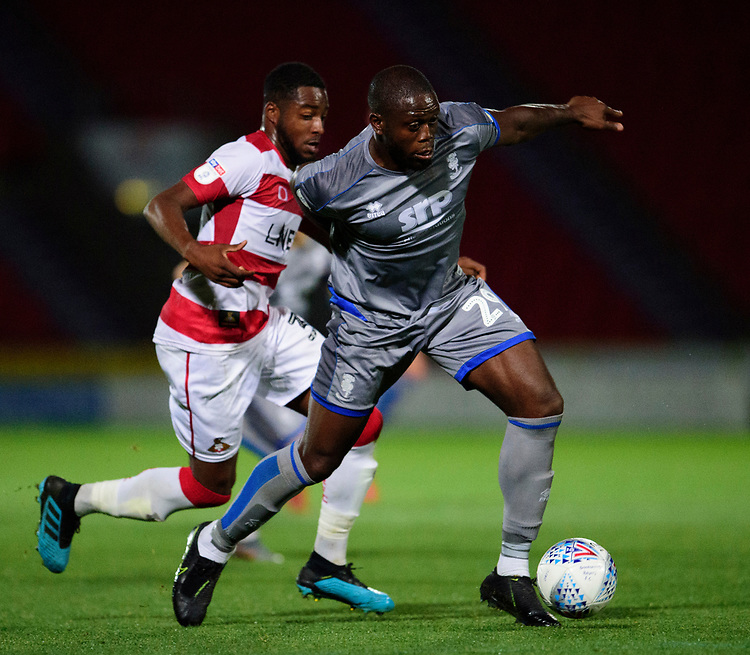 Lincoln City's John Akinde vies for possession with Doncaster Rovers' Niall Ennis<br /> <br /> Photographer Andrew Vaughan/CameraSport<br /> <br /> EFL Leasing.com Trophy - Northern Section - Group H - Doncaster Rovers v Lincoln City - Tuesday 3rd September 2019 - Keepmoat Stadium - Doncaster<br />  <br /> World Copyright © 2018 CameraSport. All rights reserved. 43 Linden Ave. Countesthorpe. Leicester. England. LE8 5PG - Tel: +44 (0) 116 277 4147 - admin@camerasport.com - www.camerasport.com