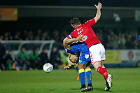 Lyle Taylor of AFC Wimbledon and Jason Pearce of Charlton Athletic tangle during the Sky Bet League 1 match between AFC Wimbledon and Charlton Athletic at the Cherry Red Records Stadium, Kingston, England on 10 April 2018. Photo by Carlton Myrie / PRiME Media Images.