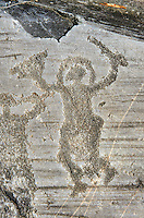 Petroglyph, rock carving, of a warrior  wearing a helmet and carrying a sword and shield. Carved by the ancient Camuni people in the iron age between 1000-1600 BC. Rock no 24,  Foppi di Nadro, Riserva Naturale Incisioni Rupestri di Ceto, Cimbergo e Paspardo, Capo di Ponti, Valcamonica (Val Camonica), Lombardy plain, Italy