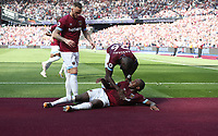 West Ham United's Michail Antonio celebrates scoring his side's first goal by stroking the newly fitted claret carpet surrounding the pitch<br /> <br /> Photographer Rob Newell/CameraSport<br /> <br /> The Premier League - West Ham United v Leicester City - Saturday 20th April 2019 - London Stadium - London<br /> <br /> World Copyright © 2019 CameraSport. All rights reserved. 43 Linden Ave. Countesthorpe. Leicester. England. LE8 5PG - Tel: +44 (0) 116 277 4147 - admin@camerasport.com - www.camerasport.com