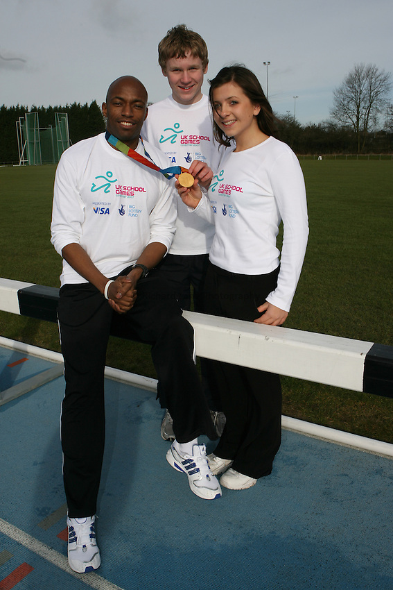 Photo: Rich Eaton...Press Conference at the launch of the 2007 UK School Games. 13/02/2007. Marlon Devonish, Olympic sprint relay gold medallist pictured with Gavin Evans from South Muskham and Caroline Hallows from Bramhall both aiming to compete in this years Games