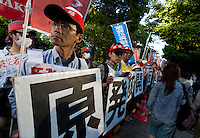 Union activists protest at an anti-nuclear demo in Shiba Park,  Tokyo, Japan Sunday June 2nd 2013