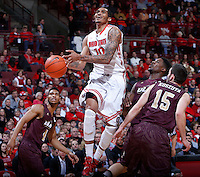 Ohio State Buckeyes forward LaQuinton Ross (10) is guarded under the basket by Louisiana-Monroe Warhawks guard R.J. McCray (4), Louisiana-Monroe Warhawks forward DeMondre Harvey (2) and Louisiana-Monroe Warhawks guard Kyle Koszuta (15) during Friday's NCAA Division I basketball game at Value City Arena in Columbus on December 27, 2013. Ohio State won the game 71-31. (Barbara J. Perenic/The Columbus Dispatch)