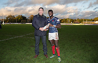 Matt Williams of London Scottish receives his MOTM bottle during the Greene King IPA Championship match between London Scottish Football Club and Jersey at Richmond Athletic Ground, Richmond, United Kingdom on 7 November 2015. Photo by Andy Rowland.