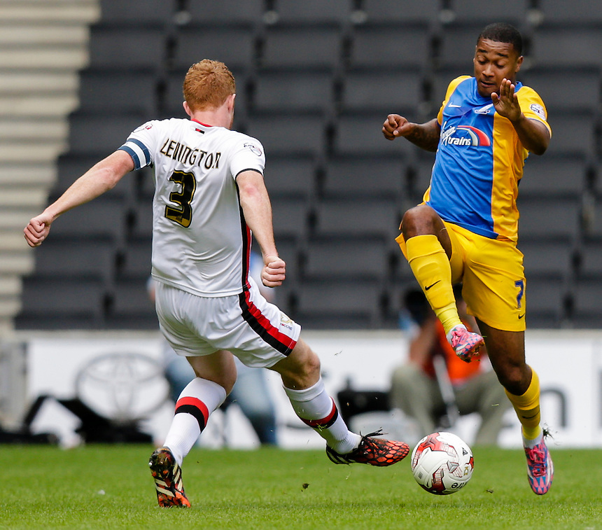 Preston North End's Chris Humphrey is tackled by Milton Keynes Dons' Dean Lewington<br /> <br /> Photographer Craig Mercer/CameraSport<br /> <br /> Football - The Football League Sky Bet Championship - Milton Keynes Dons v Preston North End - Saturday 15th August 2015 - Stadium:mk - Milton Keynes<br /> <br /> &copy; CameraSport - 43 Linden Ave. Countesthorpe. Leicester. England. LE8 5PG - Tel: +44 (0) 116 277 4147 - admin@camerasport.com - www.camerasport.com