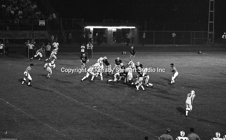 Bethel Park PA:  Offensive play with Bethel running the triple option. Clark Miller 30 running the ball off right guard after good blocks by Dennis Franks 66, Joe Barrett 75 and Don Troup 51, and Bob Hensler 77.  Others in the photo; Tom Skladany 86, Mike Stewart 11, Chip Huggins 32, John Bender 19. The offense and defense did not play well in the 12-6 defeat vs Montour. Montour's quarterback, Jim Daniels, killed the Blackhawks.  Jim Daniels was played his college ball at Pitt.  The defensive unit was one of the best in Bethel Park history only allowing a little over 7 points a game.