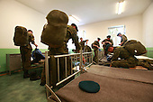 Young Polish soldiers packing up at their room on the way for the exercises at the range. Bartoszyce, Poland, May 2008<br />