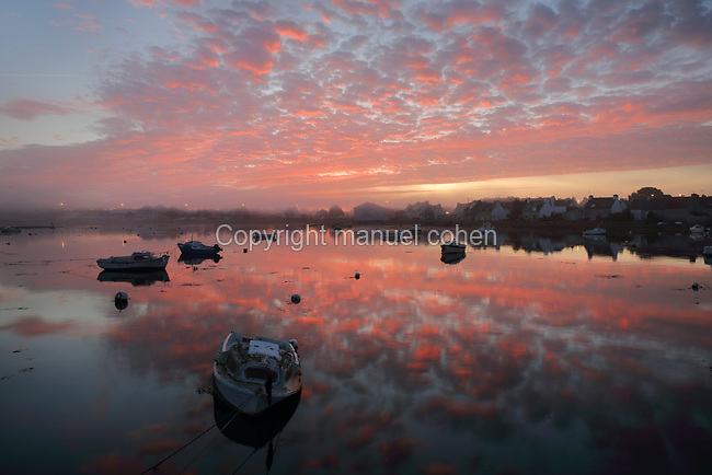 Sunrise over the inner harbour of Guilvinec-Lechiagat, Finistere, Brittany, France. This area sits behind the port of Guilvinec-Lechiagat and is littered with wrecks of boats, which can be seen at low tide. Picture by Manuel Cohen