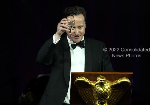 British Prime Minister David Cameron proposes a toast as he and his wife Samantha Cameron are hosted for a state dinner at the South Lawn of the White House by U.S. President Barack Obama and first lady Michelle Obama March 14, 2012 in Washington, DC. Prime Minister Cameron was on a three-day visit in the U.S. and he had talks with President Obama earlier the day.  .Credit: Alex Wong / Pool via CNP