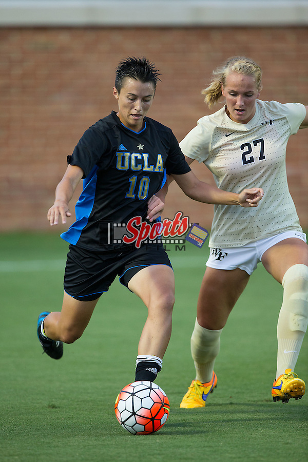 Kodi Lavrusky (10) of the UCLA Bruins keeps the ball away from Monreau DeVos (27) of the Wake Forest Demon Deacons during first half action at Spry Soccer Stadium on September 11, 2015 in Winston-Salem, North Carolina.  The Bruins defeated the Demon Deacons 2-1.  (Brian Westerholt/Sports On Film)